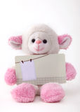 Doll holding blank card Stock Photos