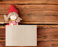 Doll Holding a Copy Space Made of Paper. Vintage Wooden Backgrou Stock Photography