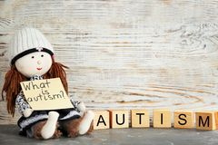 Doll holding note with phrase Stock Photography