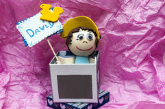 Doll holding a sign Royalty Free Stock Image