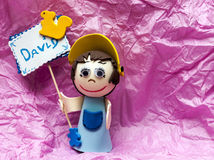 Doll holding a sign with name Royalty Free Stock Photography