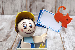 Doll holding a sign Stock Photo