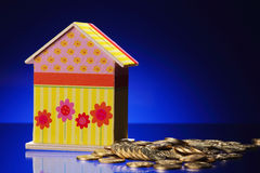 Doll house and coin Royalty Free Stock Images