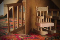Doll House Rocking Chair And Staircase Royalty Free Stock Photo