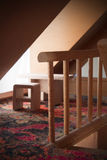 Doll House Staircase Next To Table And Chairs Stock Images