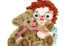 Doll hugging teddy bear Royalty Free Stock Image