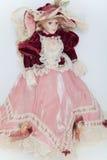 Doll lady in elegant velvet dress Royalty Free Stock Photography