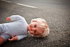 Doll leave on a highway lane Stock Image