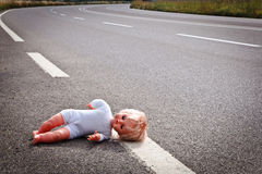 Doll leave on a highway lane. After car accident Stock Image