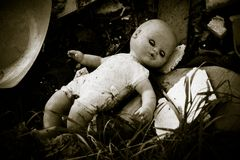 Doll left behind on a junkyard Stock Photo