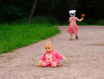 Doll left by a small girl. Pink doll left by small girl on the road Stock Photos