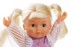 Doll with light hair on white background Royalty Free Stock Photography