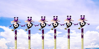 Doll-like little bee Standing in line on a background of the sky Stock Photography