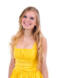 Doll-like model posing as stupid blonde. On a white background Royalty Free Stock Images