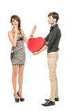 Doll looking boy and girl. Beautiful young couple looking like dolls. women and men holding big red heart shape present box isolated on white background. Copy Royalty Free Stock Image