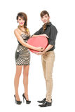 Doll looking boy and girl. Beautiful young couple looking like dolls. women and men holding big red heart shape present box isolated on white background. Copy Stock Image