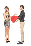 Doll looking boy and girl. Beautiful young couple looking like dolls. women and men holding big red heart shape present box isolated on white background. Copy Royalty Free Stock Images