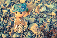 Doll. A lovely doll stand on the sand Stock Photo