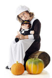 Doll-Loving Pilgrim Stock Photography