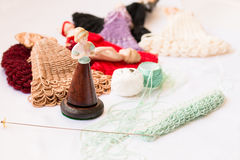 Doll mannequin and threads of beads on craft working place Stock Image