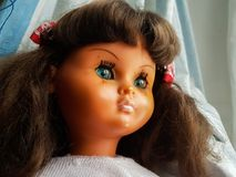 Doll with a melancholy look. They spend years and this doll seems to rejuvenate Royalty Free Stock Photo