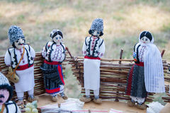 Doll men and women in the Moldovan national costumes Stock Image