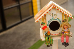 Doll and miniature house. Smiling lovely doll in front of miniature house Stock Photography