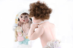 Doll with mirror Royalty Free Stock Image