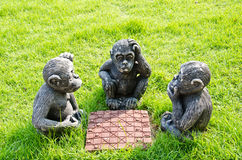 Doll monkey playing chess. Stock Photos