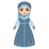 The doll in Muslim dress. Stock Photo