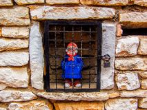 Doll of old Man Locked in Wall Cage in France Royalty Free Stock Image