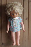 Doll old toy wooden backgrounds Stock Image
