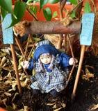 Doll op een schommeling stock foto's