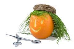 Doll orange & scissors Stock Images