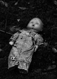 Doll and pins. An abandonned doll with pins on a tomb in a cimetarry Royalty Free Stock Photo