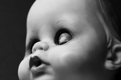 Doll Portrait. A black and white close up of an old doll Royalty Free Stock Image