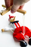 Doll puppet in the hands of Royalty Free Stock Images