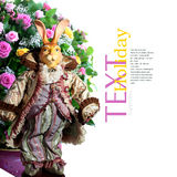 Doll rabbit. And festive bouquet Royalty Free Stock Photography