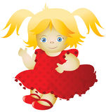 Doll in a red dress Stock Photos