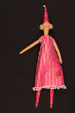 Doll in red dress. The photo shows the rag-doll in red dress Royalty Free Stock Photography