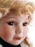 Doll's face with brown eyes. And blonde curly hair Royalty Free Stock Image