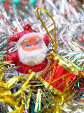 Doll of Santa Claus. With a red drum against a tinsel Stock Image