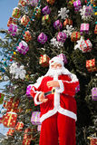 Doll Santa Claus and Christmas tree after snowfall Royalty Free Stock Photography