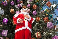 Doll Santa Claus and Christmas tree after snowfall. Royalty Free Stock Photography