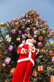 Doll Santa Claus and Christmas tree after snowfall. Stock Image