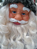 Doll with Santa Claus face Stock Images
