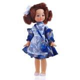 Doll in school blauwe kleding Stock Afbeeldingen