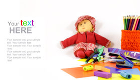 Doll and School supplies with copy space Royalty Free Stock Images
