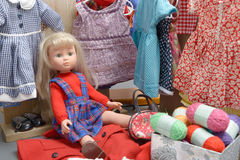 Doll with several dresses Stock Photos
