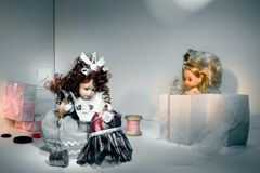 The doll sews a dress Royalty Free Stock Images